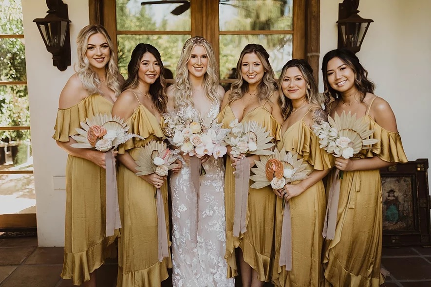 Bride wearing the Stevie wedding gown from Made with Love Bridal featured by top bridal shop, Love and Lace Bridal Salon