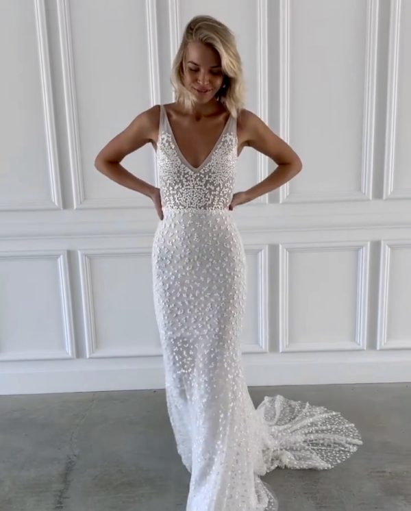 Rosey bridal gown from Made With love, available at top California bridal shop, Love and Lace Bridal Salon: image of a woman wearing the Rosey Made With Love wedding gown.